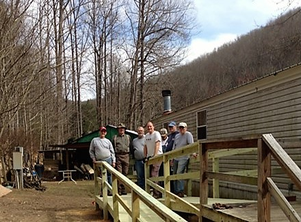 With the help of the construction supervisor and volunteers, this home now has a new ramp!