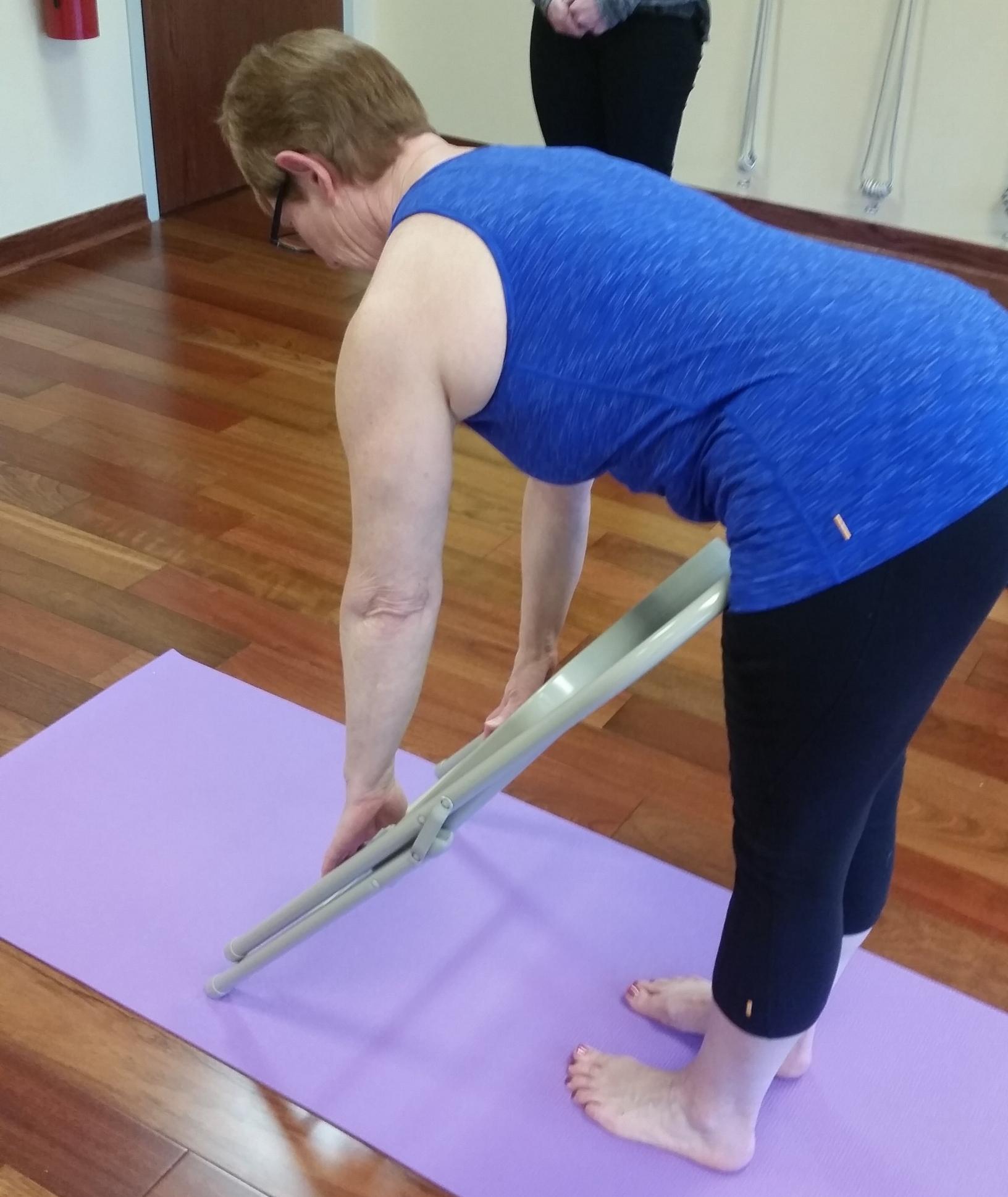 Increase hip flexion to create a long spine