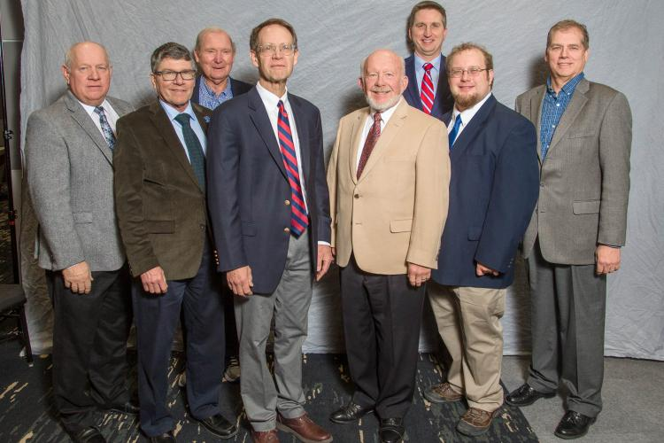 Siemer Milling announces $1 million gift to the UK Grain and Forage Center of Excellence. At the announcement at the Kentucky Commodity Conference are from front left: Warren Beeler, Governor's Office of Agricultural Policy; Robert Houtz, UK; David Van Sanford, UK; Rick Siemer, Henry Siemer and Carl Schwinke, all from Siemer Milling. Back: Lloyd Murdock and Chad Lee, both from UK. Photo by Matt Barton, UK agricultural communications.