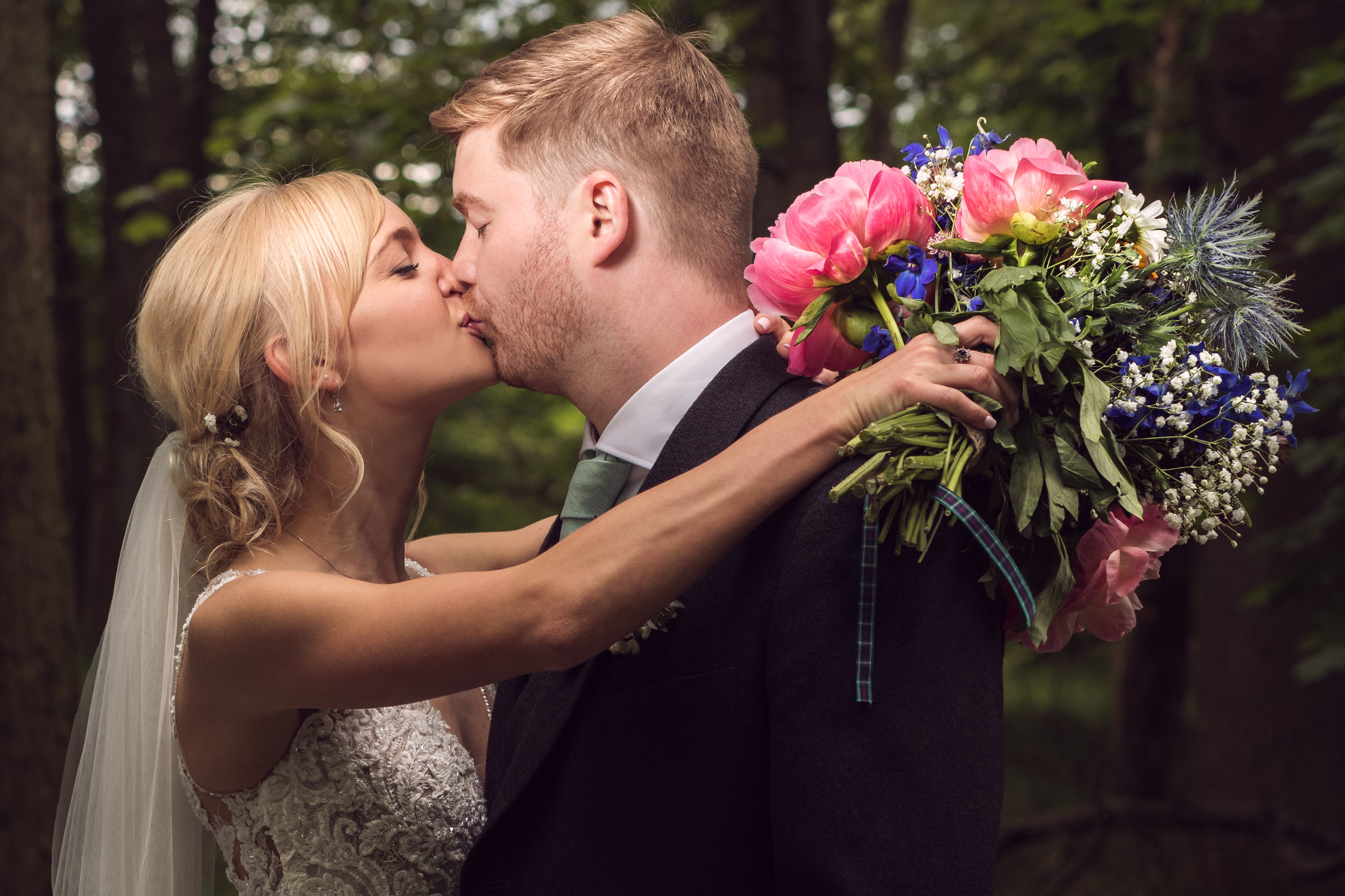 Beautiful bride and handsome groom. Wedding photographer based in Glasgow, Scotland. What a lovely wedding bouquet!