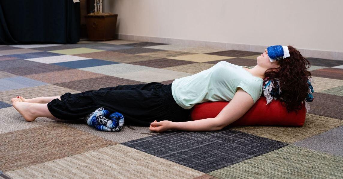 reclining over bolster full body.JPG