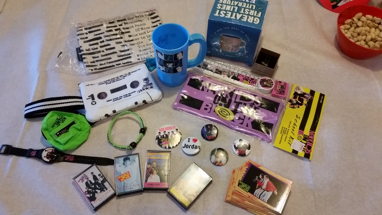 A collection of old school items my sister got me for my birthday a few years ago- trading cards, buttons, the bubble gum cassette tapes, watch, cup, and school set.