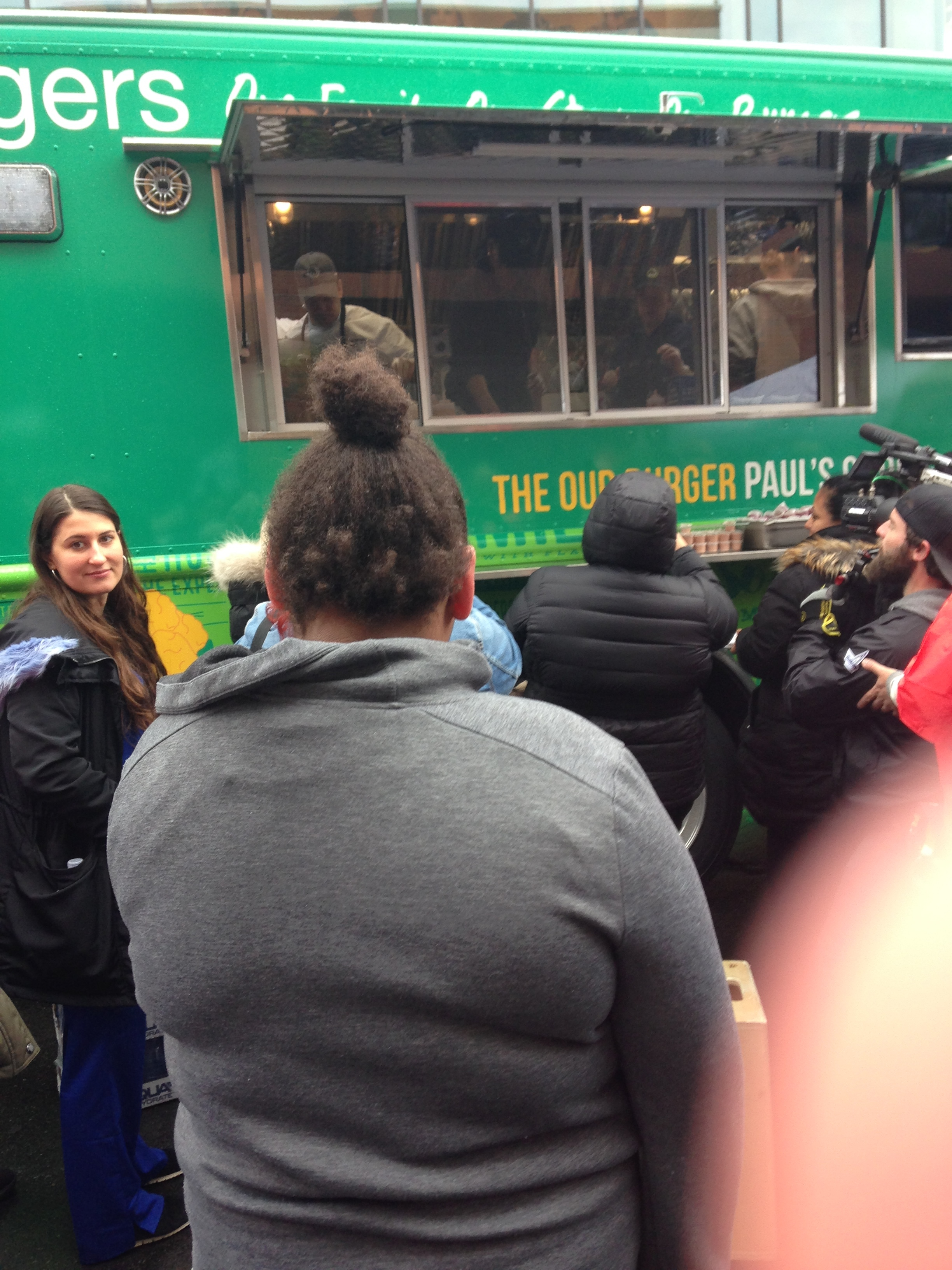 Trying to catch a glimpse of Paul in the food truck