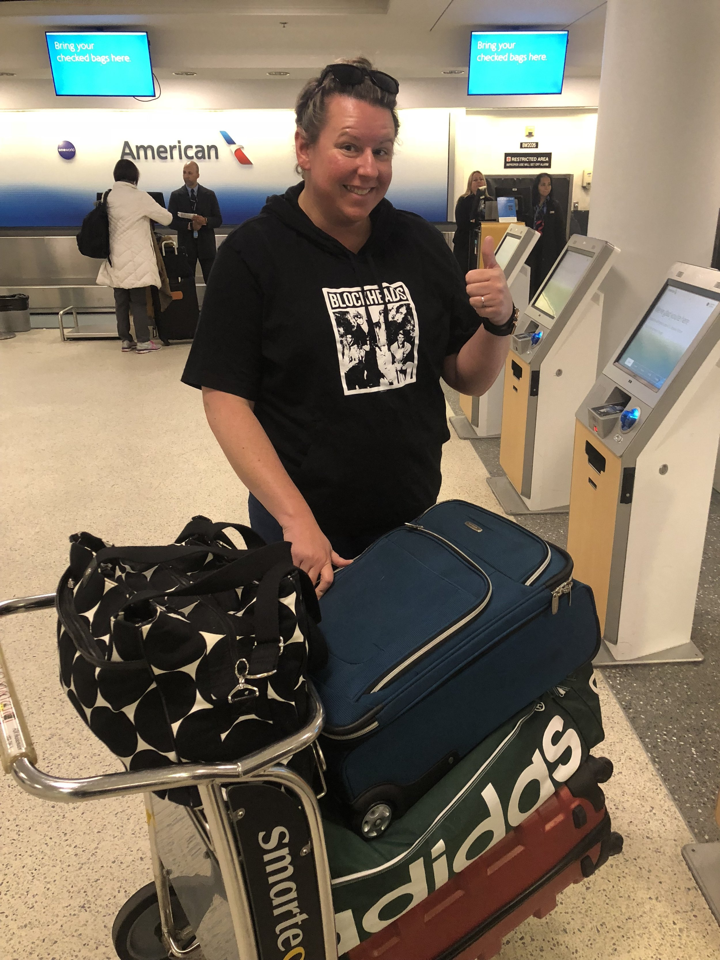 Nikki, sporting her new NKOTB hoodie and her pile of luggage