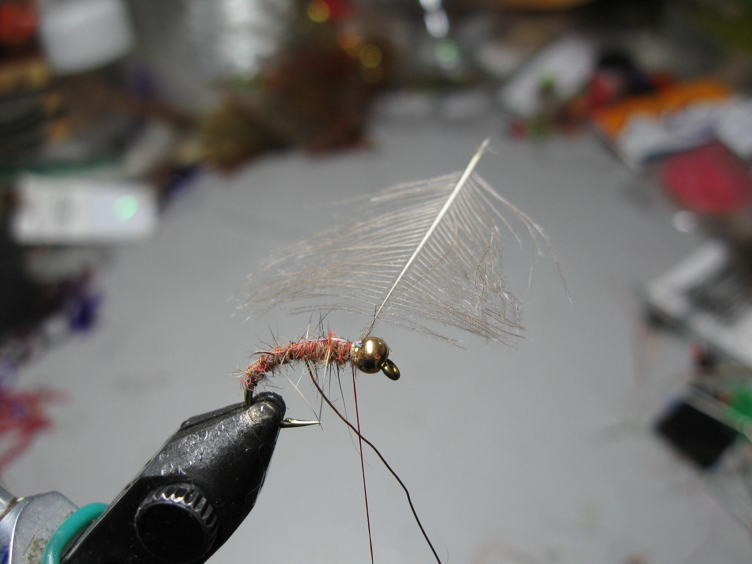 5. This job will be made a great deal easier when you start winding the wire rib. Keep the turns even and fairly open. Aim to place five or six turns along the shank. Make sure your winding pressure does not take the Mylar to the far side of the hook.