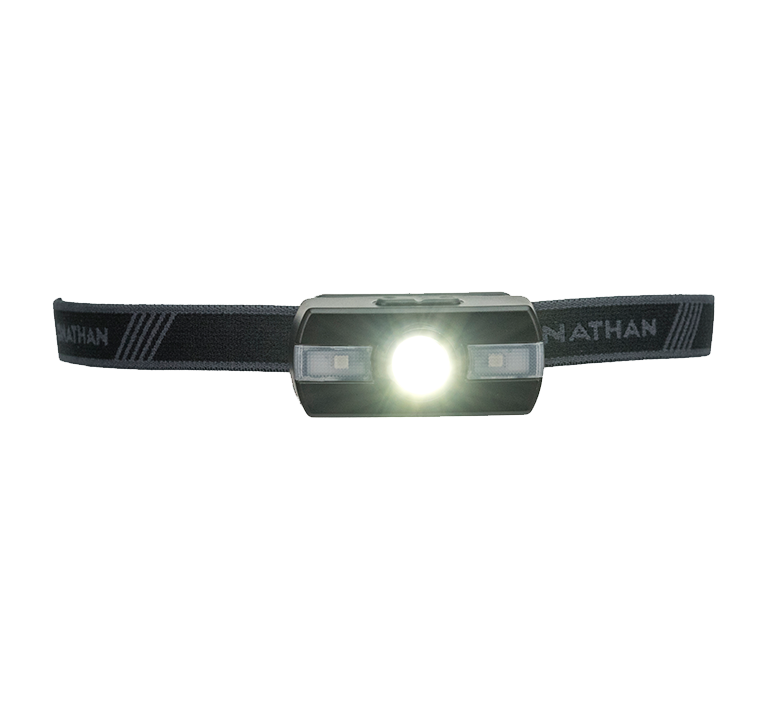 Features & Benefits  Bring added safety and color to your night run with the lightweight and powerful Neutron Fire. The primary LED kicks out a crisp 115 lumen spotlight, while the two side strobes offer RGB Light – red, green, or blue LED's for added visibility.  Lightweight, low-profile runners' headlamp  5 lighting modes: low, medium, high, sprint, strobe  RGB Light – red, green, & blue LED options for side strobes  115 Lumens LED spotlight  Replaceable AAA batteries  Specs:  Main LED: 115 max lumens  Side LED's - RGB Light: Red, Green, or Blue  Battery: 2x AAA batteries, replaceablev  Burn Time: 30+ hours  Water Resistance: IPX4 – Weather resistant  Adjustable headlamp angle   Neutron FireTM Runners' Headlamp Usage Instructions - Download the PDF   Lighting Modes:  Low – 25 Lumens  Medium – 45 Lumens  High – 90 Lumens  Sprint – 115 Lumens  Strobe – 45 Lumens