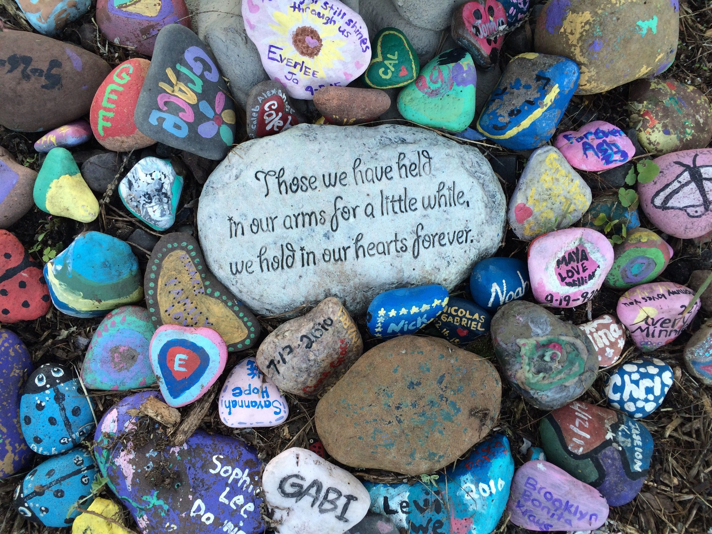 A collection of lovingly painted stones to remember children who have died. Faith's Lodge, Danbury, WI.