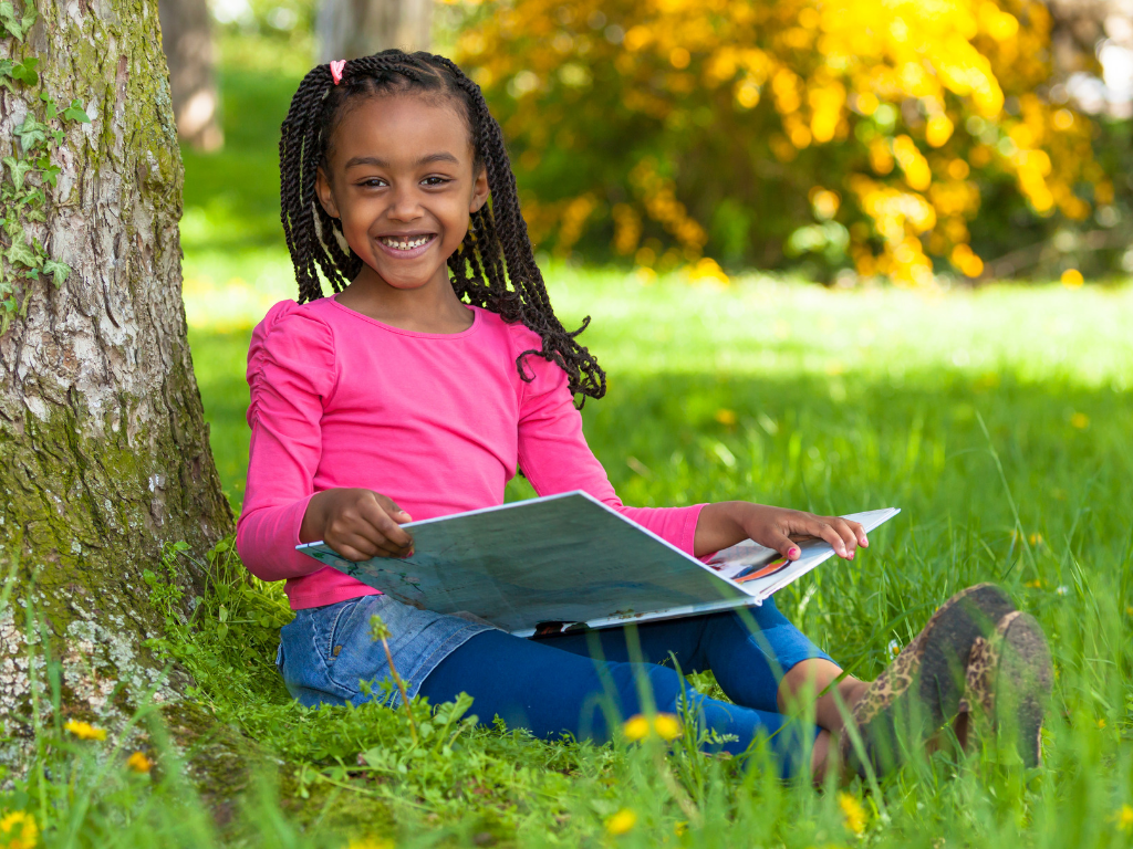 Girl reading and smiling.png