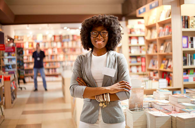 Woman Standing in Bookstore.png
