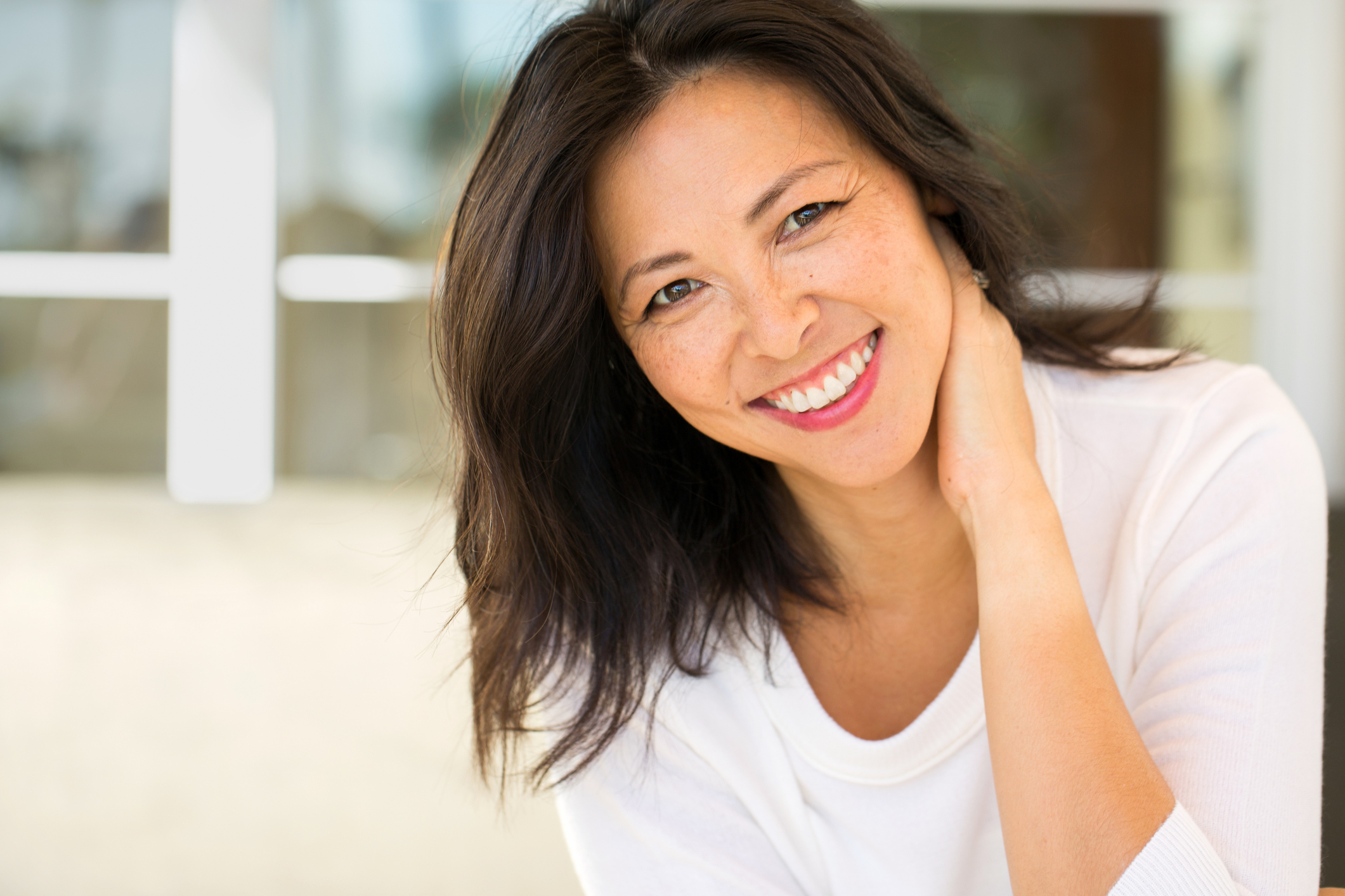 Portrait-of-an-Asian-woman-smiling.-911966802_2125x1416.jpeg