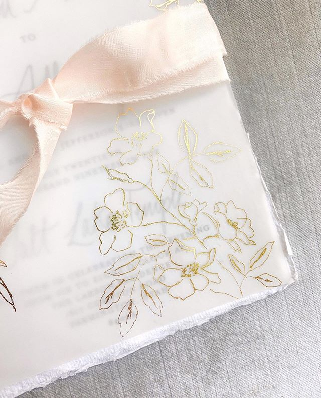 SEVEN HUNDRED of these beauties left the studio today and are on their way to homes all around the world 💌 • So much heart went into this suite. From the delicate hand drawn florals, custom venue illustration, touches of gold, to the deckled edges all wrapped together with blush raw silk ribbon - this suite has been an absolute career high for me 🥰 • A special thanks to @raaaacho for being my extra pair of hands this past weekend. Together we assembled 300+ envelopes in one sitting and wow, having 20 fingers moving instead of 10 really changes the game! • Stay tuned for this stunning summer wedding to come this July with @rachaelellenevents and @kenzievictory ✨