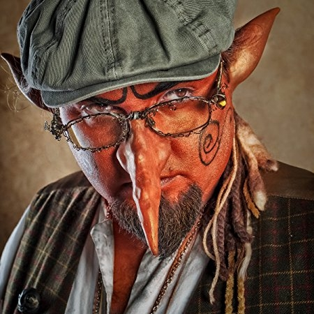 Gandersnitch the Goblin - Robert A. Turk is an entertainer, author, poet, sculptor, mask maker, game designer, and slightly odd individual. He lives in a very old and possibly haunted house in Ohio, with his wonderful wife, his two incredibly creative children, an old lazy dog, and some rather uncolorful fish.