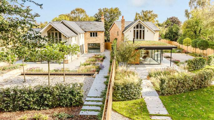 The property on the left is for sale for £1.95m (01223 459501,  struttandparker.com )