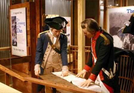 The Crossing of the Dan exhibit opens much like the beginning of the Southern Campaign of the American War for Independence. In the opening scene, General Nathanael Greene instructs his Quartermaster, Lt. Col. Edward Carrington, to explore the Dan and Yadkin Rivers to find an efficient route for transporting supplies to his army in North Carolina. Little did they know that this fateful decision would later save the American war efforts.