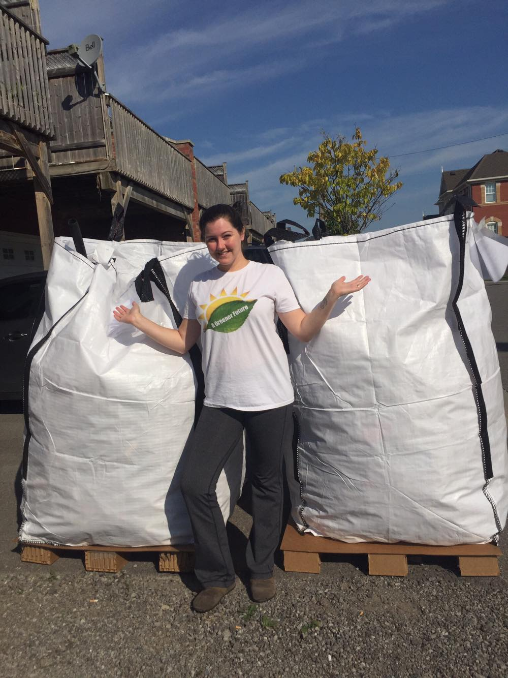 Rochelle Byrne, A Greener Future's Executive Director,with two super-sacks full of beach plastic from Love Your Lake 2017.