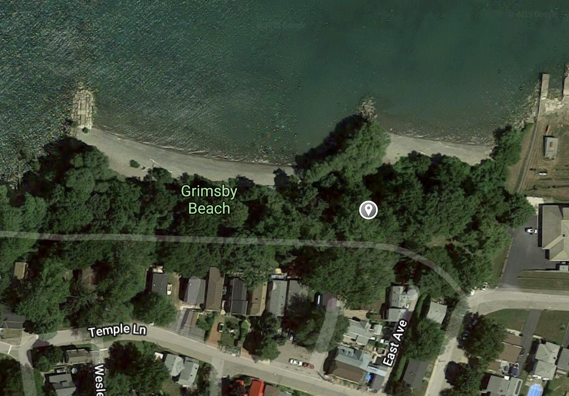 You'll find us at the top of the stairs that lead down to the beach indicated by the grey marker.