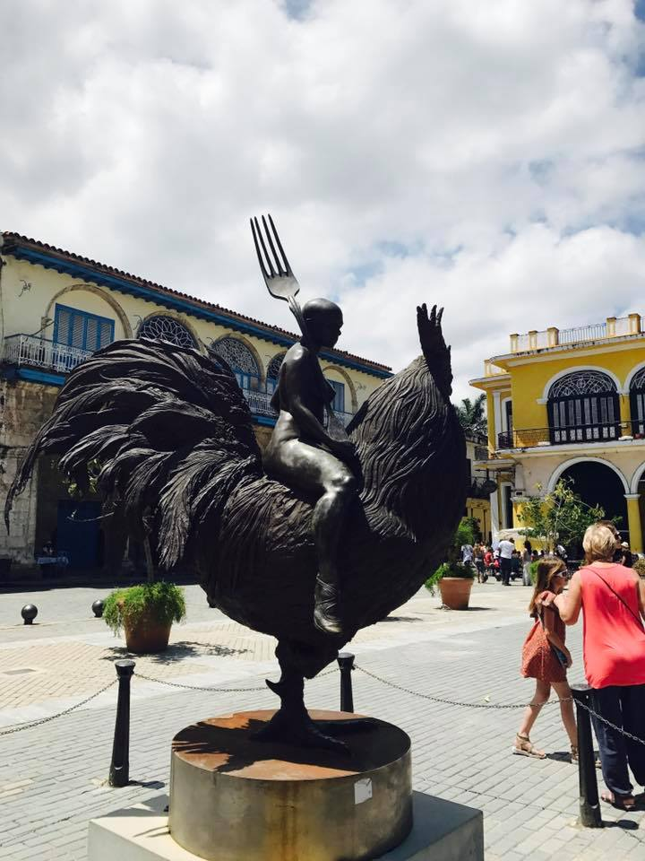 Plazas are way more interesting when they include fork-wielding rooster lady statues.