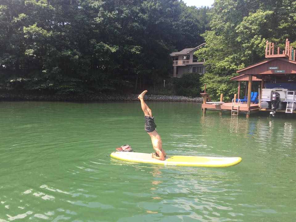 Maybe in a couple years, Lewis will be able to do headstands on paddle boards like his dad.