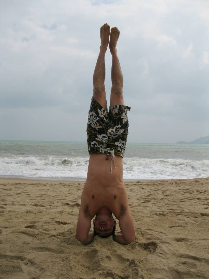 The beach is an ideal spot to practice head stands.