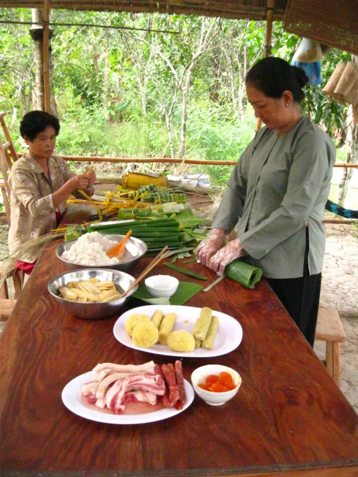 Making banh tet - a special rice and meat roll made for the Vietnamese new year.
