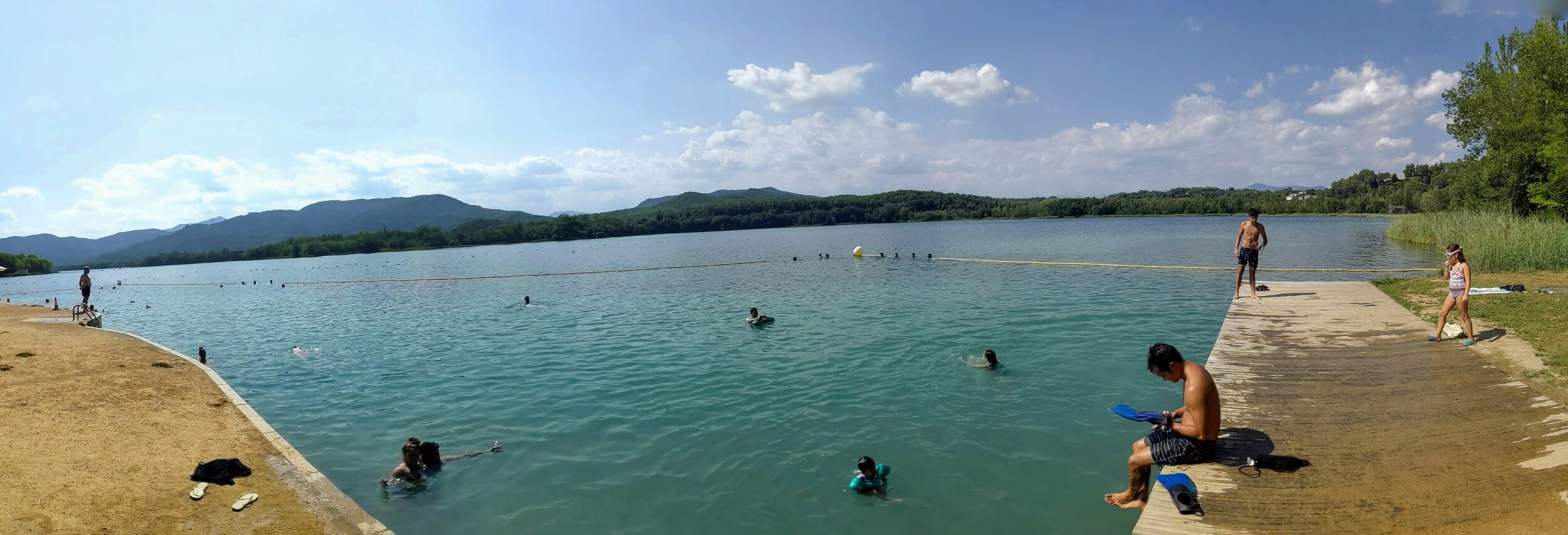 The swimming area at Caseta de Fusta with a dock for jumping. Out of frame is a shallower area with an easier entrance for littler kids.
