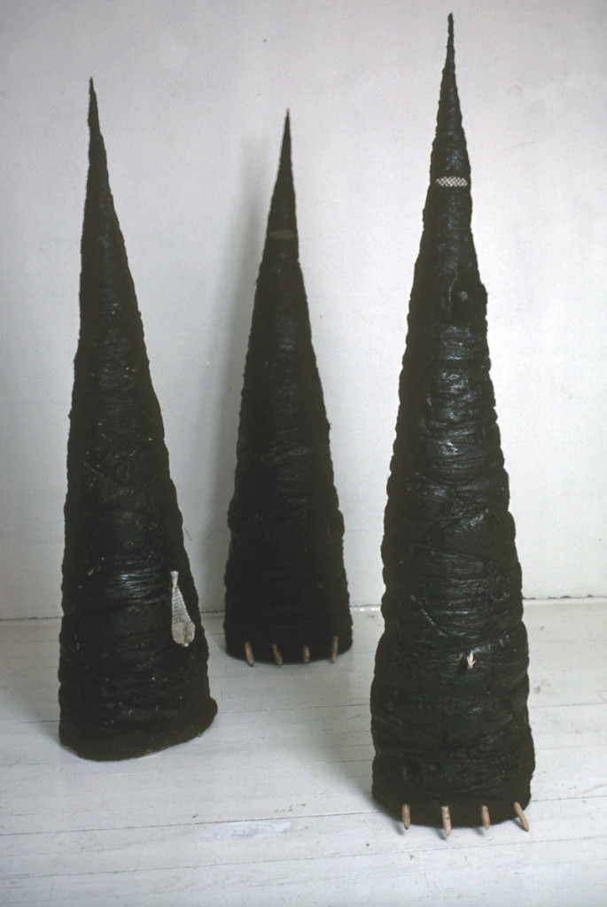 3 Sculptures, 1977, canvas strips, tar, string, wire mesh, approx. 67 x 12 x 11 inches. Courtesy the artist.