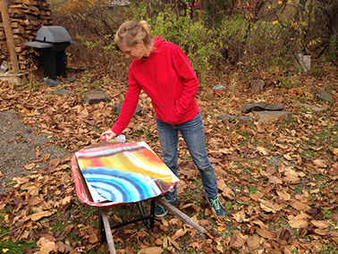 Lisa Sanditz spray painting outside her studio in Tivoli, NY. Photo by Tim Davis, courtesy the artist.