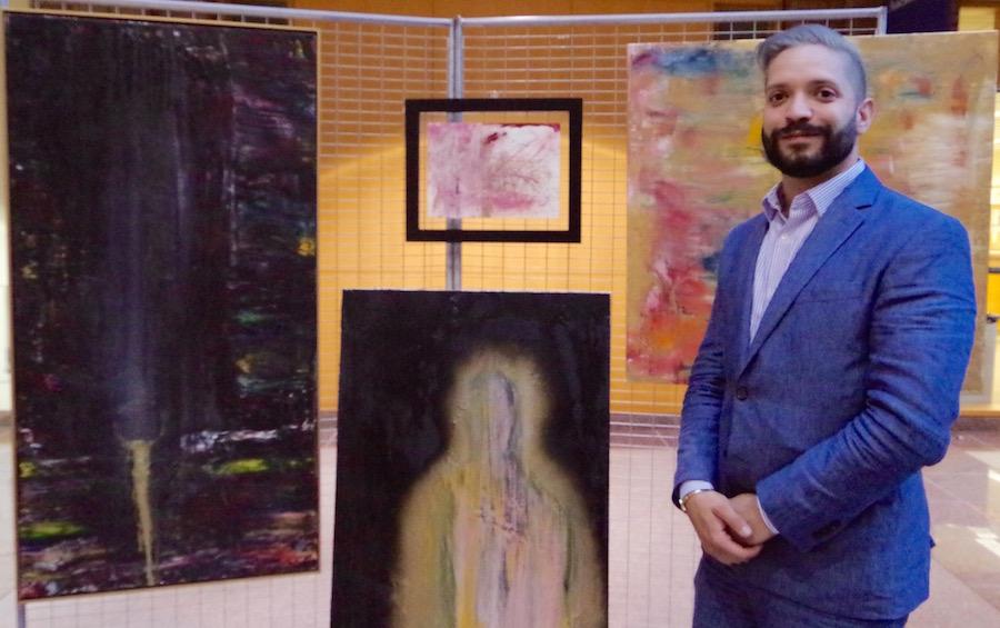 Jonathan Joseph Ganjian with his work.