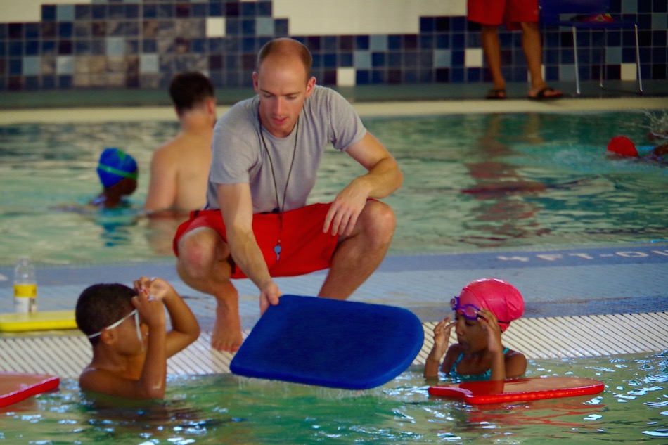 Instructor Brian Coppage with two students. Coppage, who has been teaching for over seven years, is now the head teacher/lifeguard on duty at John D. Martinez.