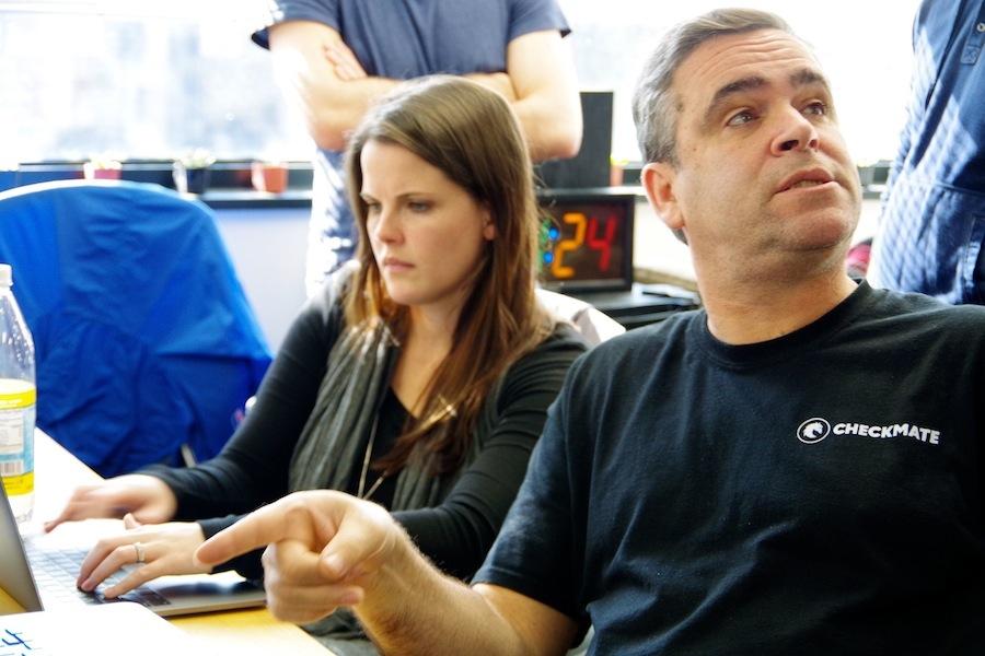 Employees Megan Newlan and John Knight hard at work.