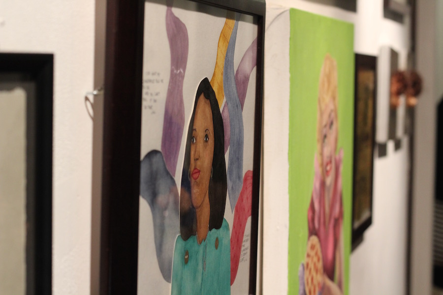 Gabriella Svenningsen's delicate watercolor of Angela Davis is one in a packed hallway of eye-catching work.