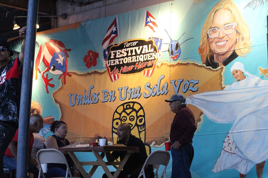A banner outside with the theme. Artists David Sepulveda and Amie Ziner had been working on it for weeks, preparing it for the city's large stage on the green.