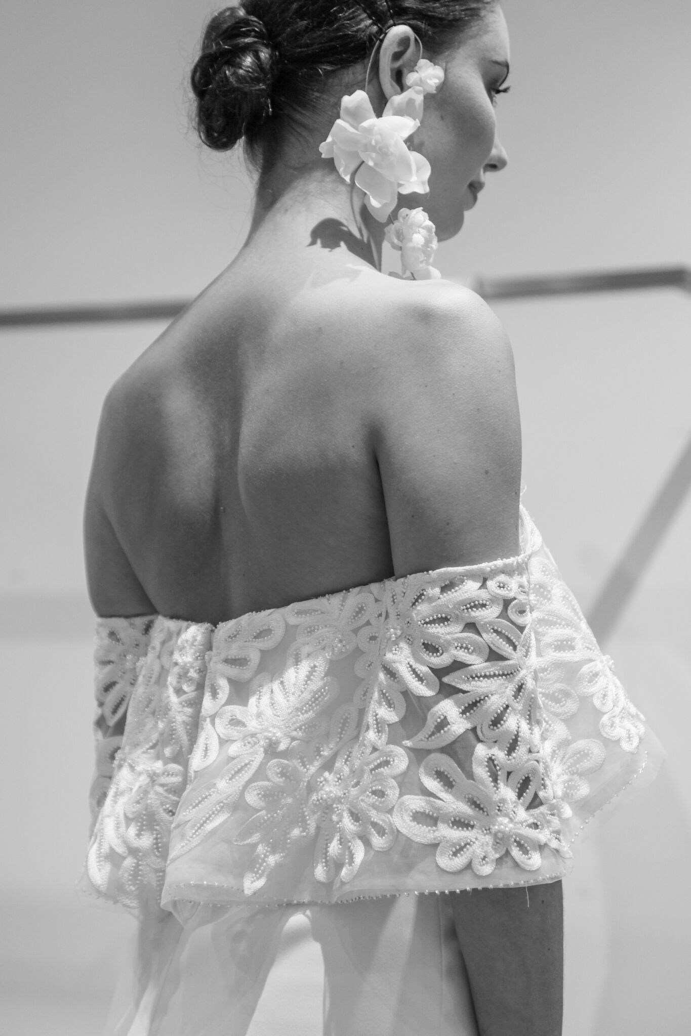Lela Rose follows the off the shoulder ready-to-wear trend by creating a lace wedding dress for the chic bride. And can we talk about those earrings!?