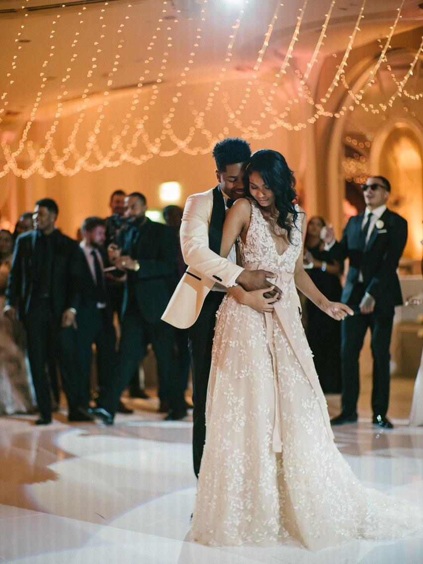 Wedding reception dress with sash and bow at waistline