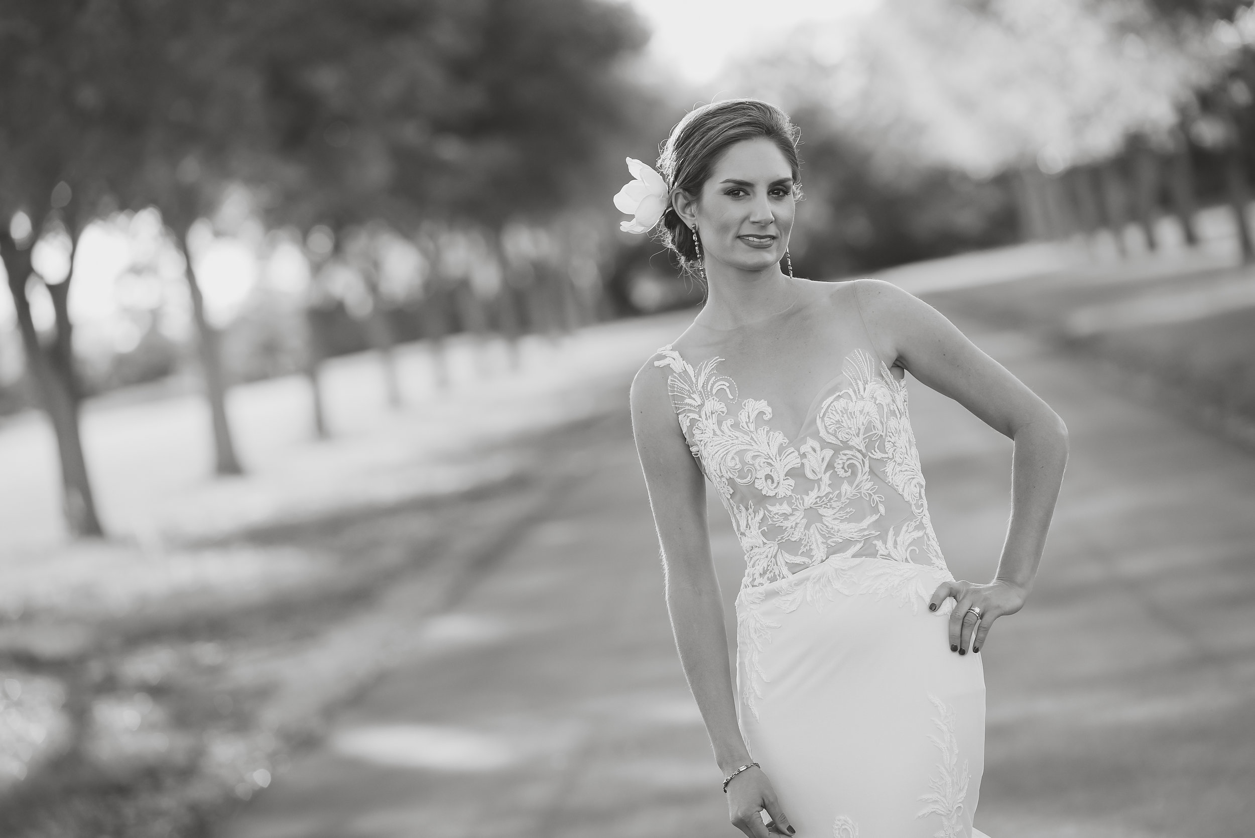 Bride wearing Ines Di Santo wedding gown with lace and one shoulder detail