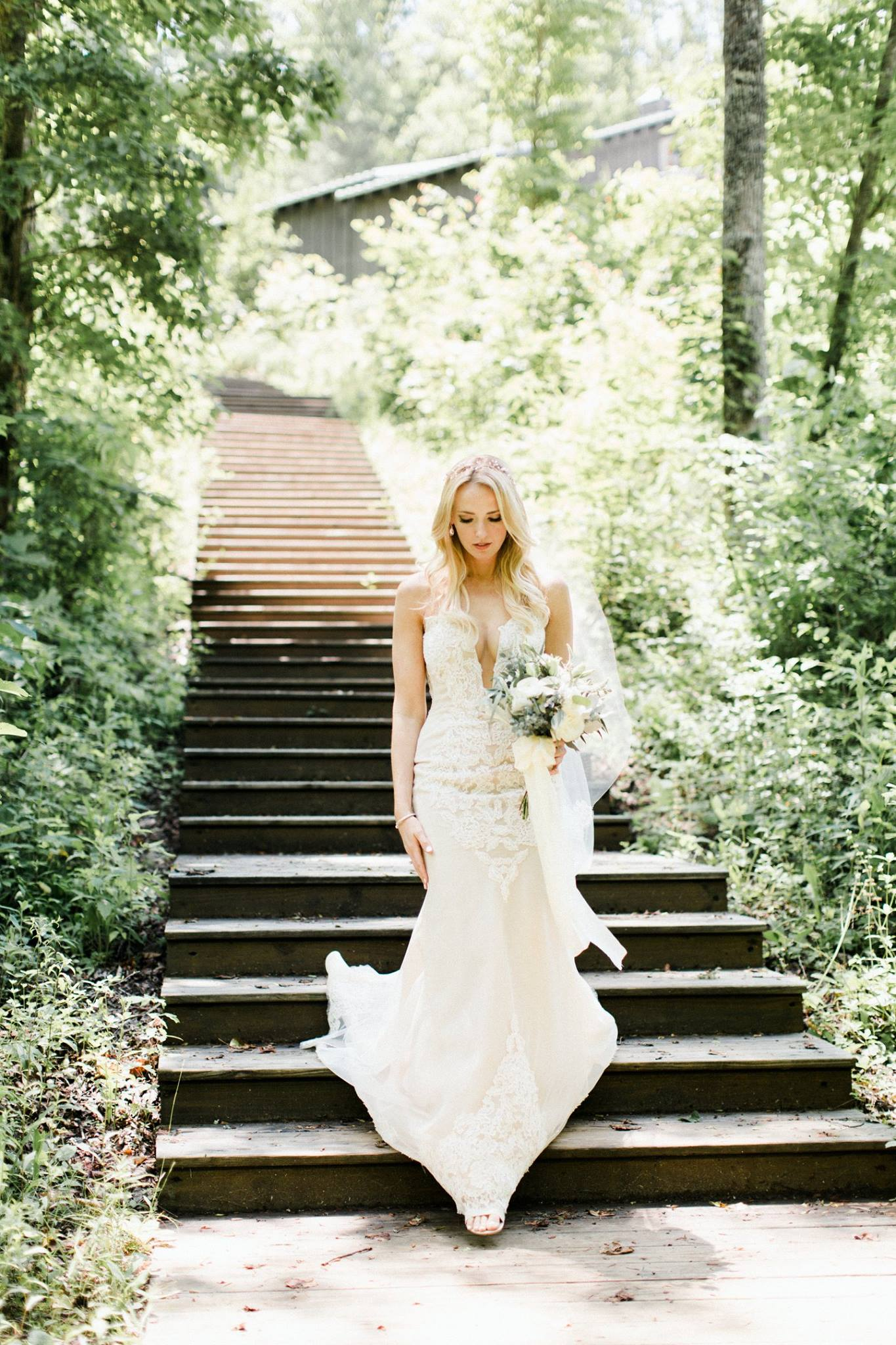 kari walking down the staircase in her wedding dress to meet rob