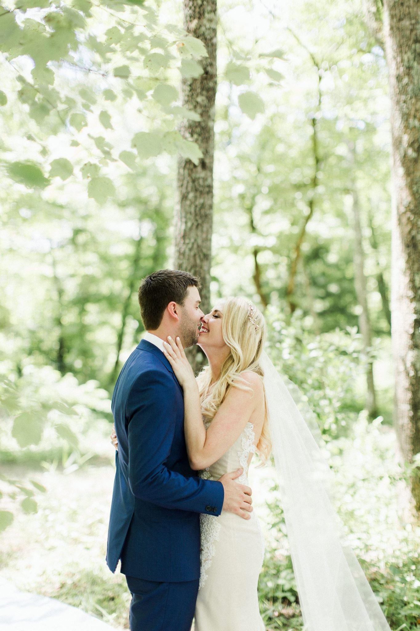 kari wearing ines di santo wedding dress with girl and a serious dream veil
