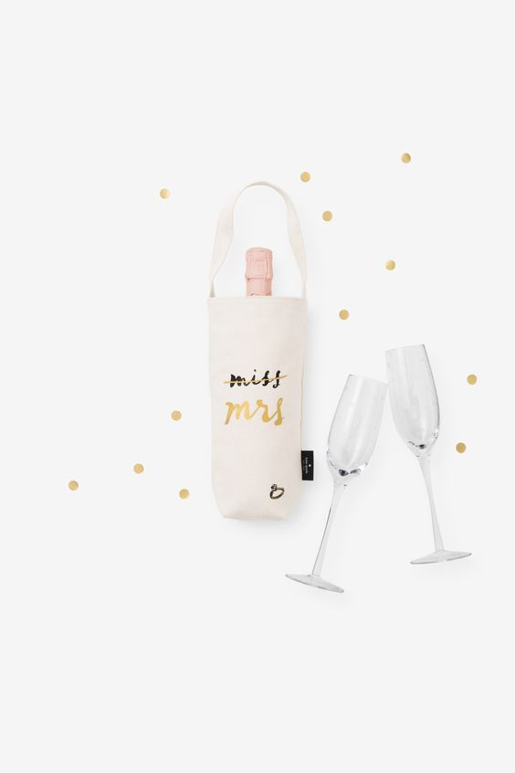 Love this Kate Spade champagne carrier with the flutes. This is perfect for a newly engaged bride!