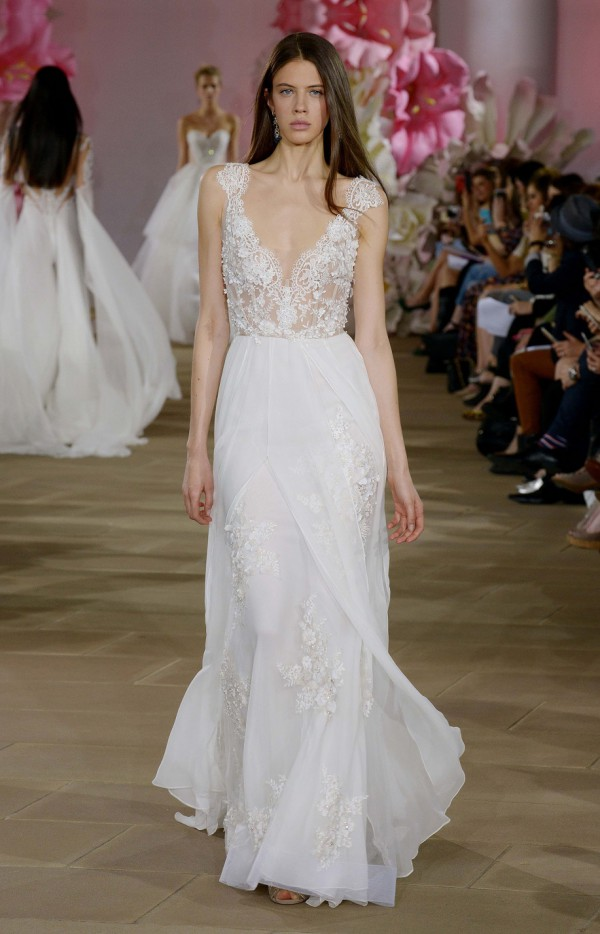 Low v-neck wedding dress with chiffon skirt and beaded appliqués details by Ines Di Santo