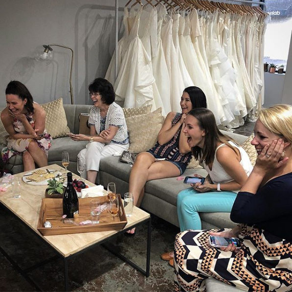 Our bride, Kat's friends & family after she said YES to her dress! Can you tell they love her dress? Congratulations, Kat!
