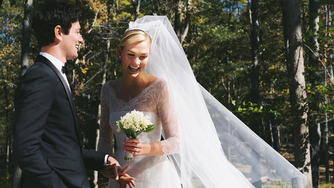Karlie Kloss wore a long sleeve lace ball gown dior wedding gown 2018 influencing wedding