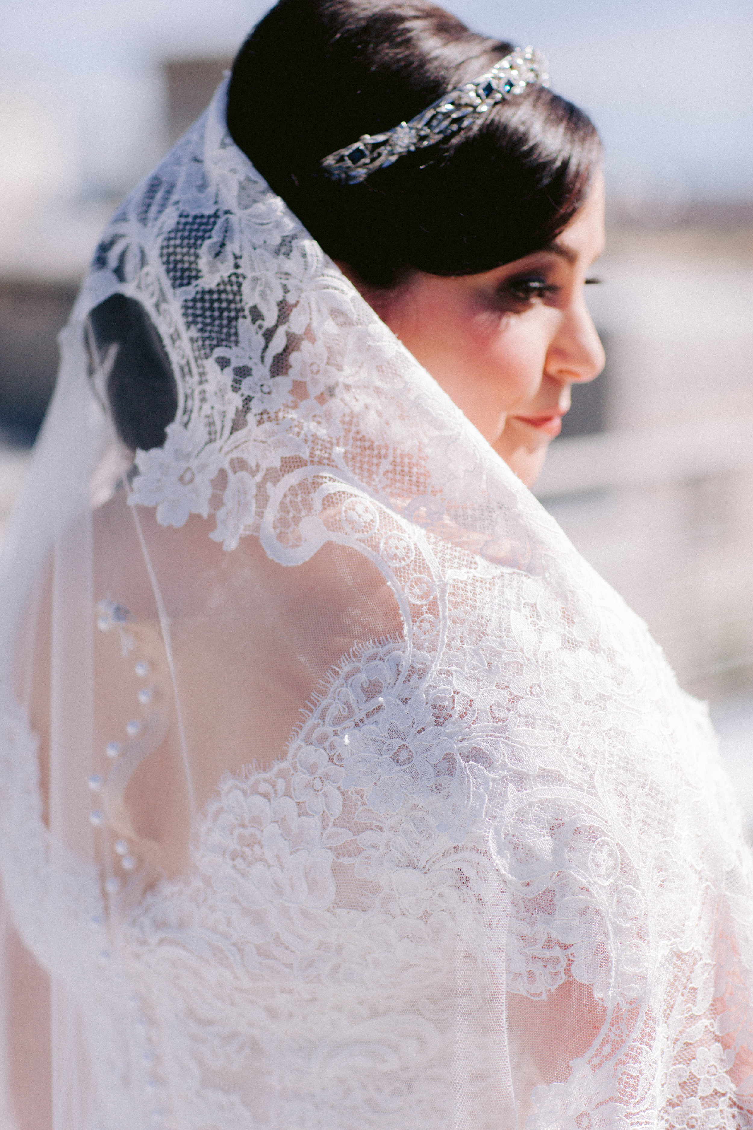 bride wearing a the madrid matilla veil by girl and a serious dream chantilly lace veil