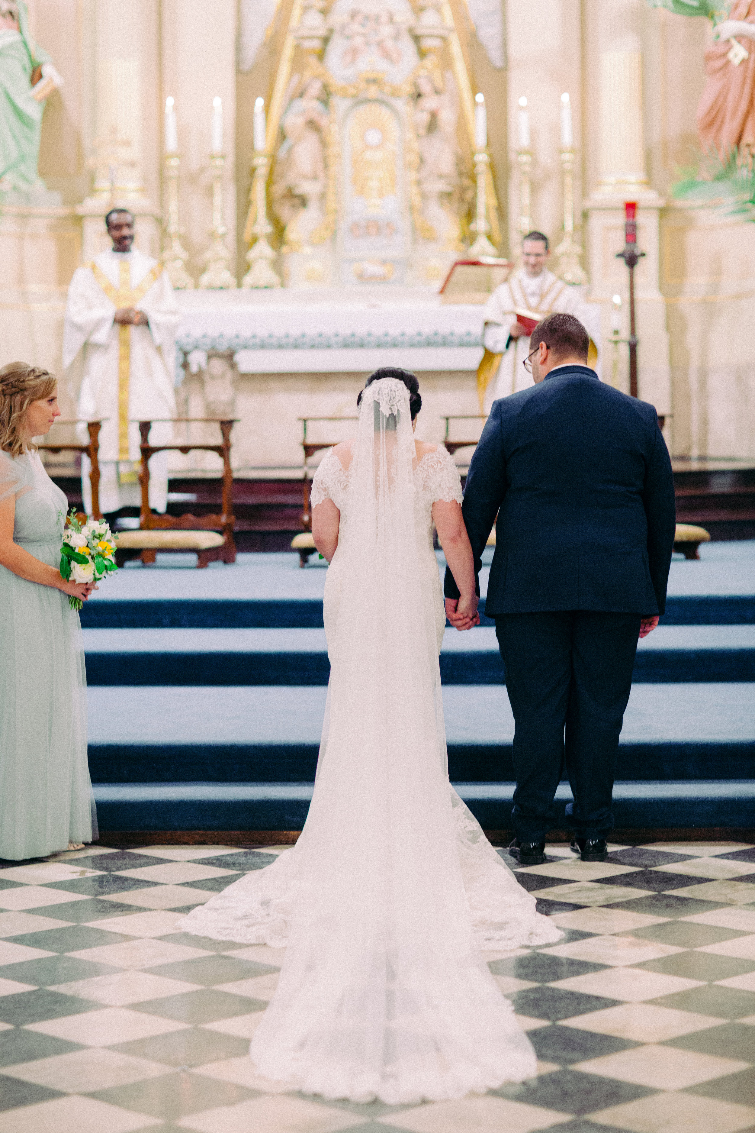 catholic wedding at a basilica in new orleans. Bride wearing madrid mantilla veil by girl and a serious dream to classic wedding in new orleans