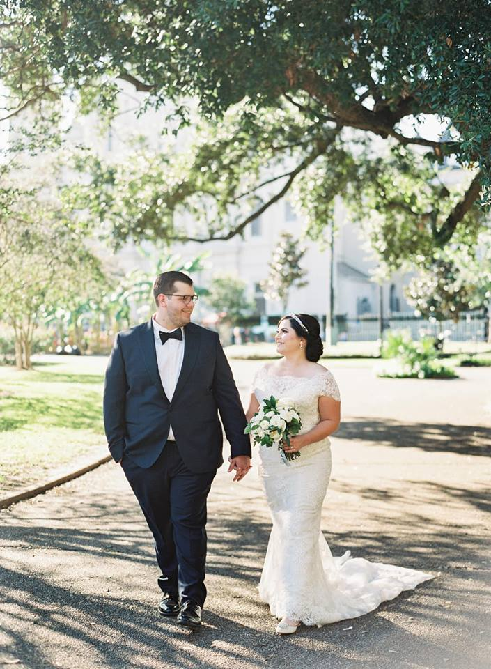 ines di santo bride wearing a lace mermaid off the shoulder gown at her new orleans wedding