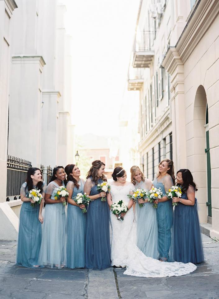 blue bridesmaids dresses and lace ines di santo gown at southern wedding in Louisiana