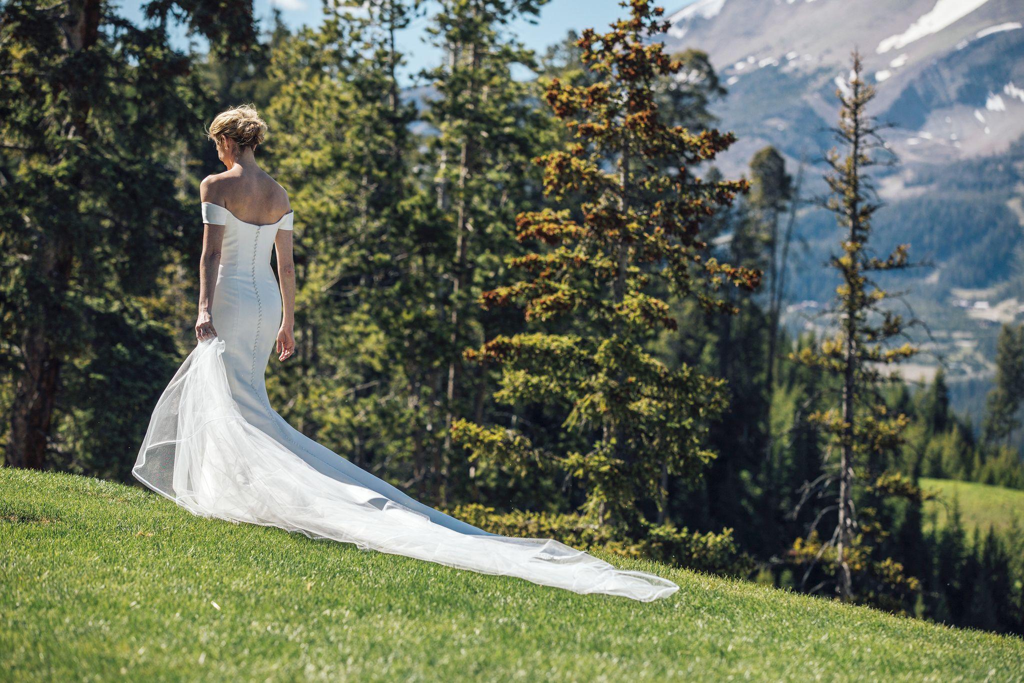 off the shoulder Carolina Herrera wedding gown Erin Andrews wedding gown