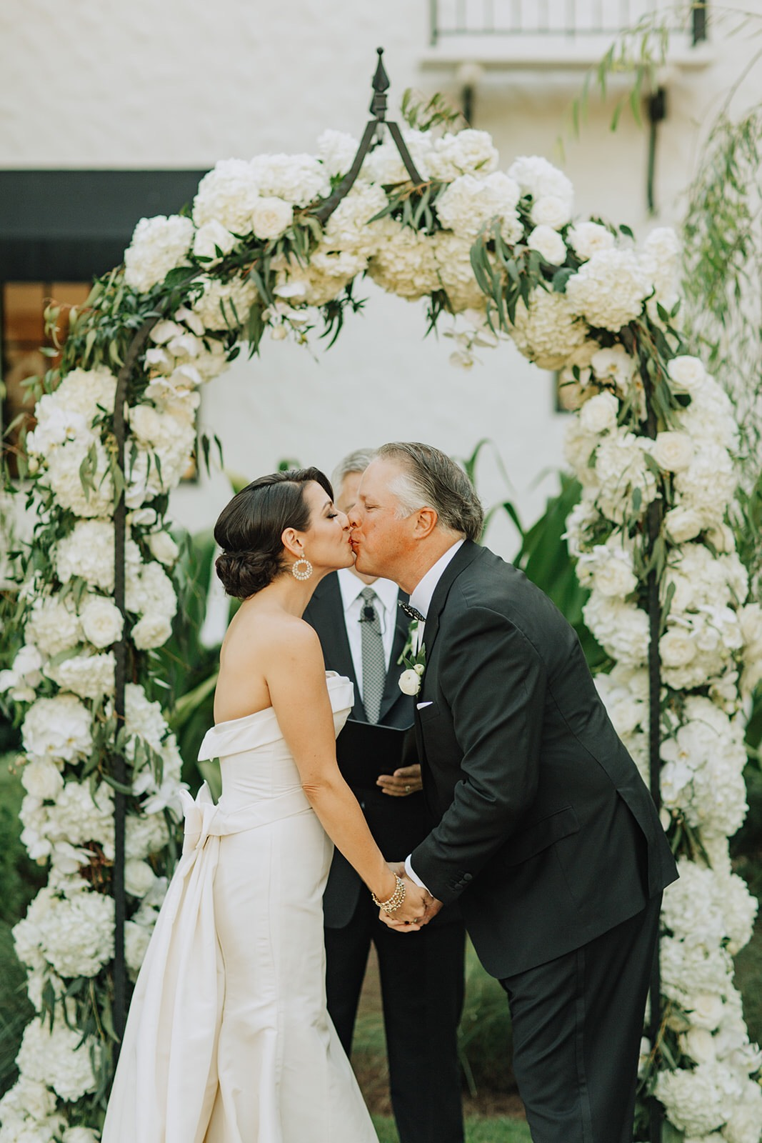 Padgett McCormick wearing Carolina Herrera silk faille wedding dress