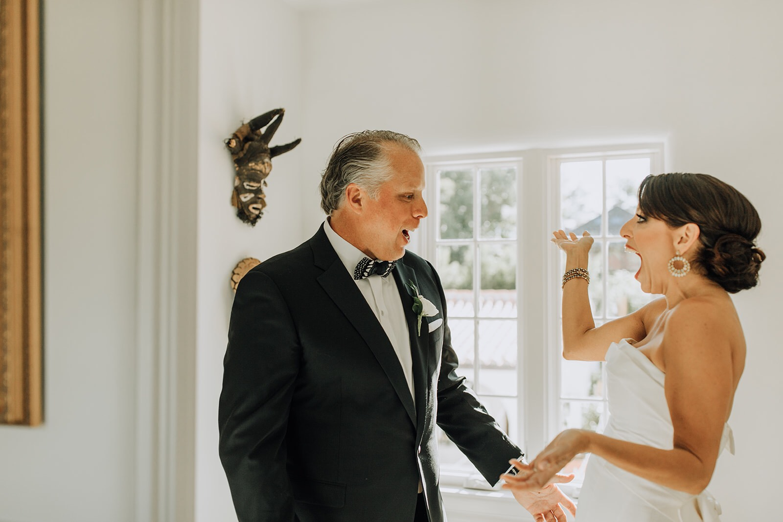 Bride wears Carolina Herrera strapless gown paired with her fiancé in a custom black suit