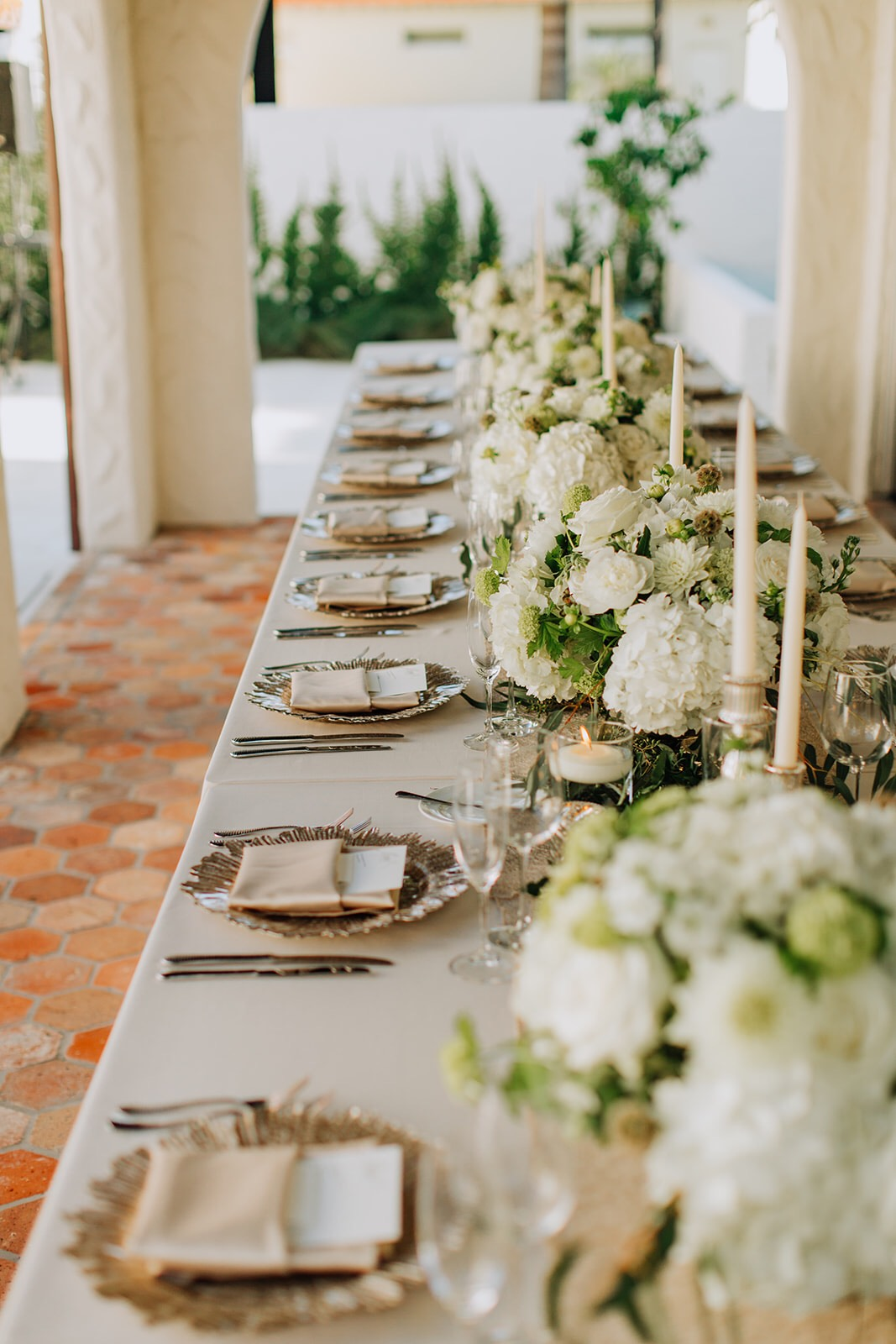 Table setting for Winter Park, Florida wedding with white floral decor