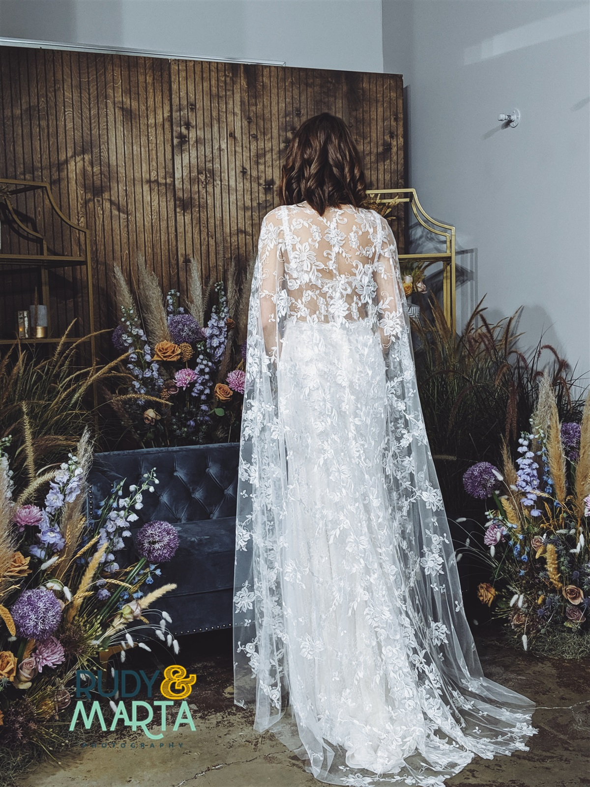 girl and a serious dream bridal lace cape in bloom florist central florida wedding vendors